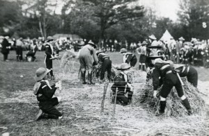 Group of boys from the Harvey Goodwin Home at a Scout camp 'making straw mattressess', c1913.