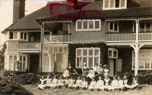 Photograph of matron, staff and children outside 'Coronation Cottage', St David's Home, Broadstairs, Kent, c1912