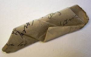 Crumpled document removed from envelope
