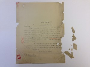 A typed letter with fragments before lining