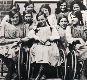 Girls at St. Nicholas' Hospital and Special School, Pyrford, Surrey. Three are in wheelchairs. [1915]