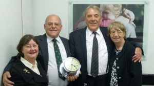 Michael and Richard Pollard and their wives with the ship's clock