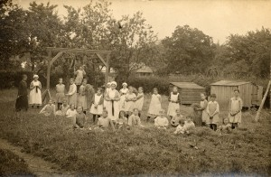 Twenty four girls and 5 members of staff in the garden of the Eastnor Home in 1920
