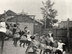 Girls from St Monica's sitting on a see-saw, 1897