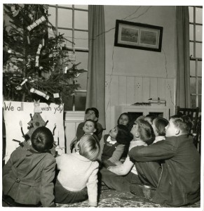 Children in one of The Society's children's homes in the 1940s alongside their Christmas tree