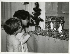 Two girls looking at a nativity display in one of The Society's homes, 1950s
