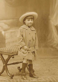 This portrait of a little girl shows her wearing her Sunday Best. All the Society's children had a set of 'best' clothes to go to church in.