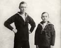 Brothers wearing sailor suits