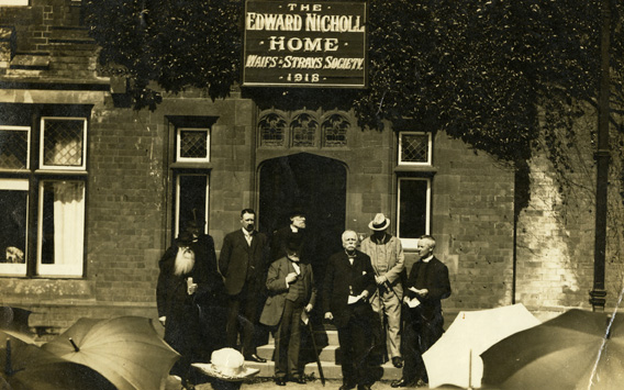Group at the front of the Edward Nicholl Home For Babies during the opening ceremony