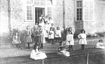 Here the girls are displaying a variety of their toys. Some are playing 'sticks and hoops' while others are holding their croquet sticks.