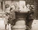 Children drinking from  fountain