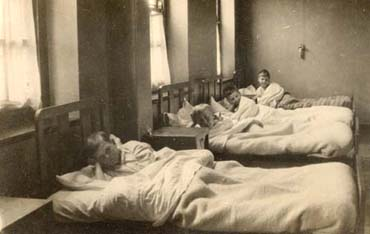 Children's homes were run to a rigid timetable to ensure that everybody was tucked up in bed at the same time. We are not certain which home this photograph is of - but it may be the Gordon Home For Boys in Croydon.