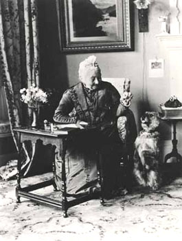 Visitors to children's homes would arrive and be entertained in the reception room. This lady with the dog is Miss Bailey, who was the wife of St Andrew's founder.