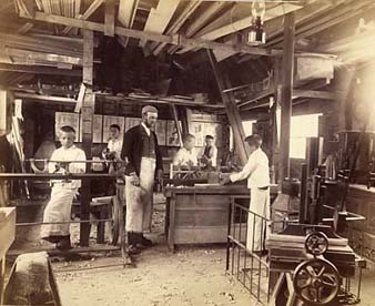 The carpentry workshop at Standon had some advanced machinery, like the treadle lathe on the left of this picture.